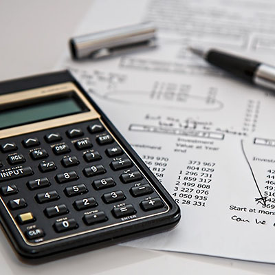 Calculator with a piece of paper showing some figures