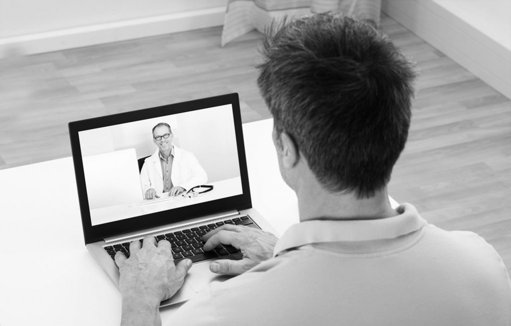 Man having a video conference with a doctor on a laptop